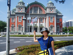 Showpiece: Festival guide Mie Nakaoka in front of Osaka's elegant Central Public Hall on Nakanoshima Island