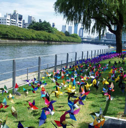 Among the 'Aqua Metropolis Osaka' festival's attractions are a field of pinwheels by the Tosabori River; a workshop where visitors can make trendy sandals from old soccer boots.
