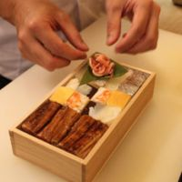 Finishing touch: A worker at the venerable, seventh-generation Yoshino Sushi shop prepares one of its famed traditional Osakan hakozushi (boxed sushi) meals.