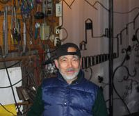 Surprise finds: Koichi Kikuchi does his metalwork in a cavelike smithy, while Tomoya Katsumata works on a table leg in the bowels of the Scandinavian Furniture Service store.