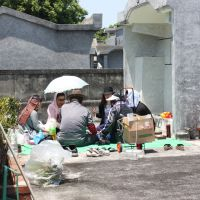 Ritual pleasures: During the Shimi festival in April, an Okinawan family party with their ancestors at their tomb in the 10-hectare Shikina Cemetery Park in Naha (below), since their late forebears are believed to still be spiritually alive among them. | HILLEL WRIGHT PHOTOS
