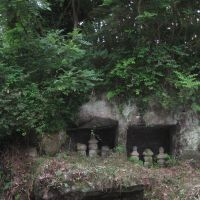 Spirit markers: Ancient gorinto tombstones still populate caves at Mandarado Yagura.