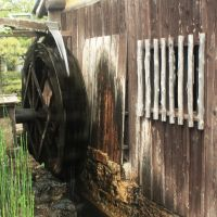 Age-old ways: Water wheels like this one (left) at the Kiku-Masamune Sake Brewery Museum in Kobe, were long the sole power source in the making of sake. | ALON ADIKA