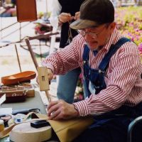 Bags of skill: A leather-worker plies his trade at the fair.   CRAFTS FAIR MATSUMOTO
