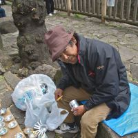 Cash for ash: Rikuro Miyake with some of the &#165;100 ashtrays he makes from cans.