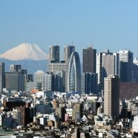 High rises: A zoom lens makes Mount Fuji appear much closer than its actual 100 km from the center of  Tokyo and the Shinjuku district's massed ranks of lofty ambitions.