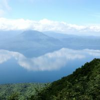 Double vision: Lake Shikotsu with clouds floating on it (above), and the  1,898-meter cone of Mount Yotei (bottom right), as seen from the slopes of Mount  Tarumae. The map shows the five separate areas comprising the Shikotsu-Toya National Park, being the ones around each of those two large lakes, the areas centered on the towns of Jozankei and Noboribetsu, and that around Mount Yotei. | MARK BRAZIL PHOTOS