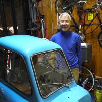 The wheel deal: Professional tinkerer Takamasa Seki with his turquoise Peel P50. | KIT NAGAMURA PHOTO