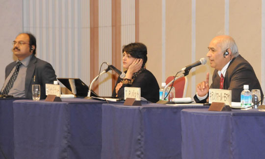 Taranath Parameshwar Bhat (right), a professor at the Institute for Studies in Industrial Development, speaks while other panelists Ram Upendra Das (left) and Sanjana Joshi listen during the Jan. 20 symposium at Keidanren Kaikan in Tokyo. | SATOKO KAWASAKI PHOTO