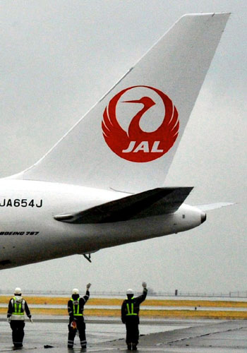 Symbolic journey: Sporting its new crane logo, a Japan Airlines Co. plane prepares to depart from Tokyo's Haneda airport Monday for Kushiro, Hokkaido, on a commemorative flight. | YOSHIAKI MIURA PHOTO