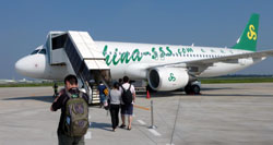 Niche market: Passengers board a Spring Airlines plane at Ibaraki Airport last September. | KYODO PHOTO