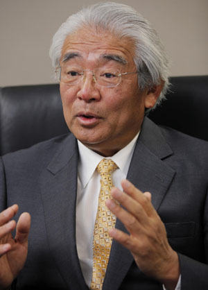 Breathing easier: Toyota Motor Corp. adviser Toshiaki Taguchi is interviewed at Toyota's Tokyo office in February. | AP PHOTO