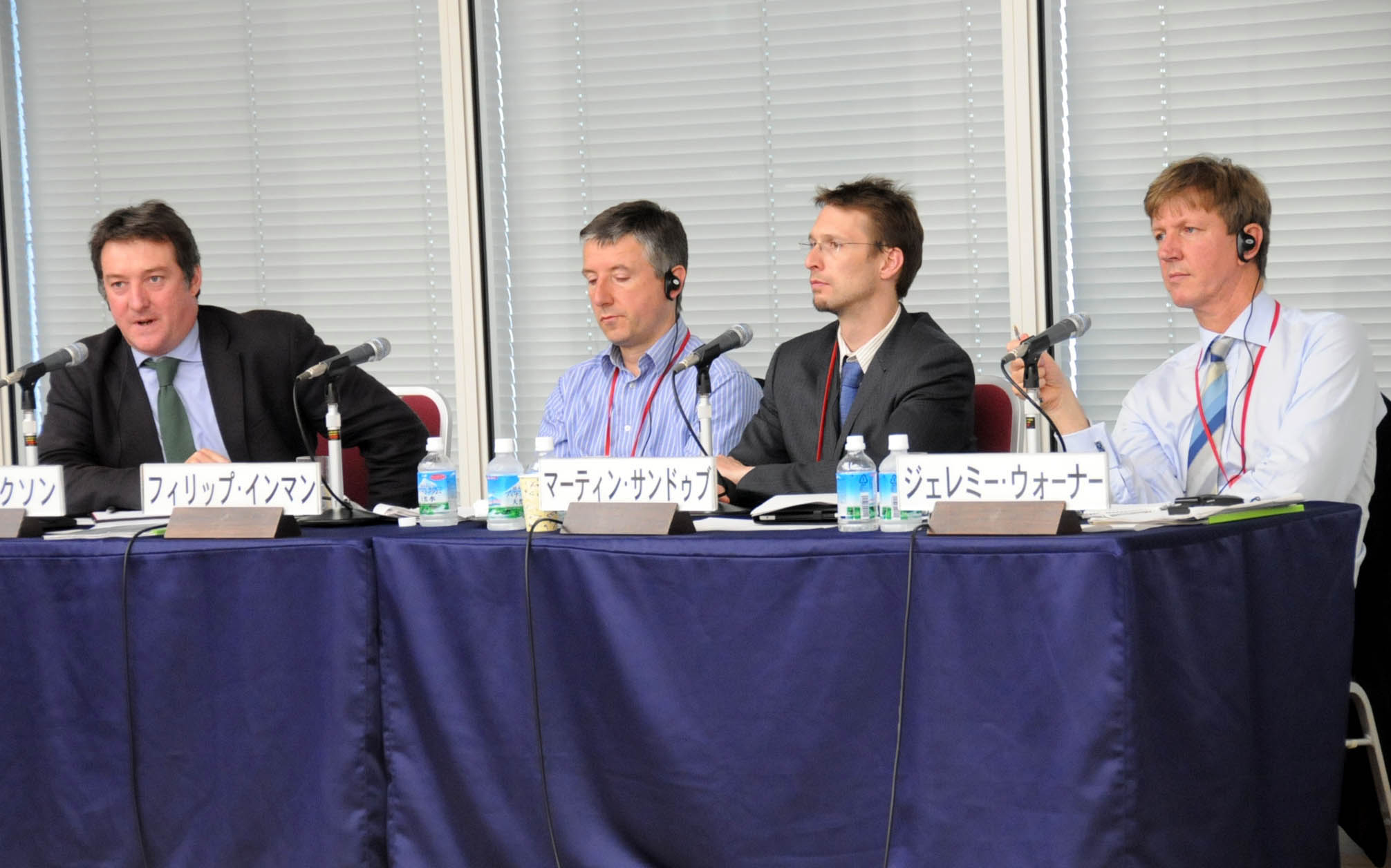 Journalists from Britain (from left) Simon Nixon, Phillip Inman, Martin Sandbu and Jeremy Warner discuss economic challenges for Japan and the United Kingdom during a symposium at Keidanren Kaikan in Tokyo on June 24. | SATOKO KAWASAKI