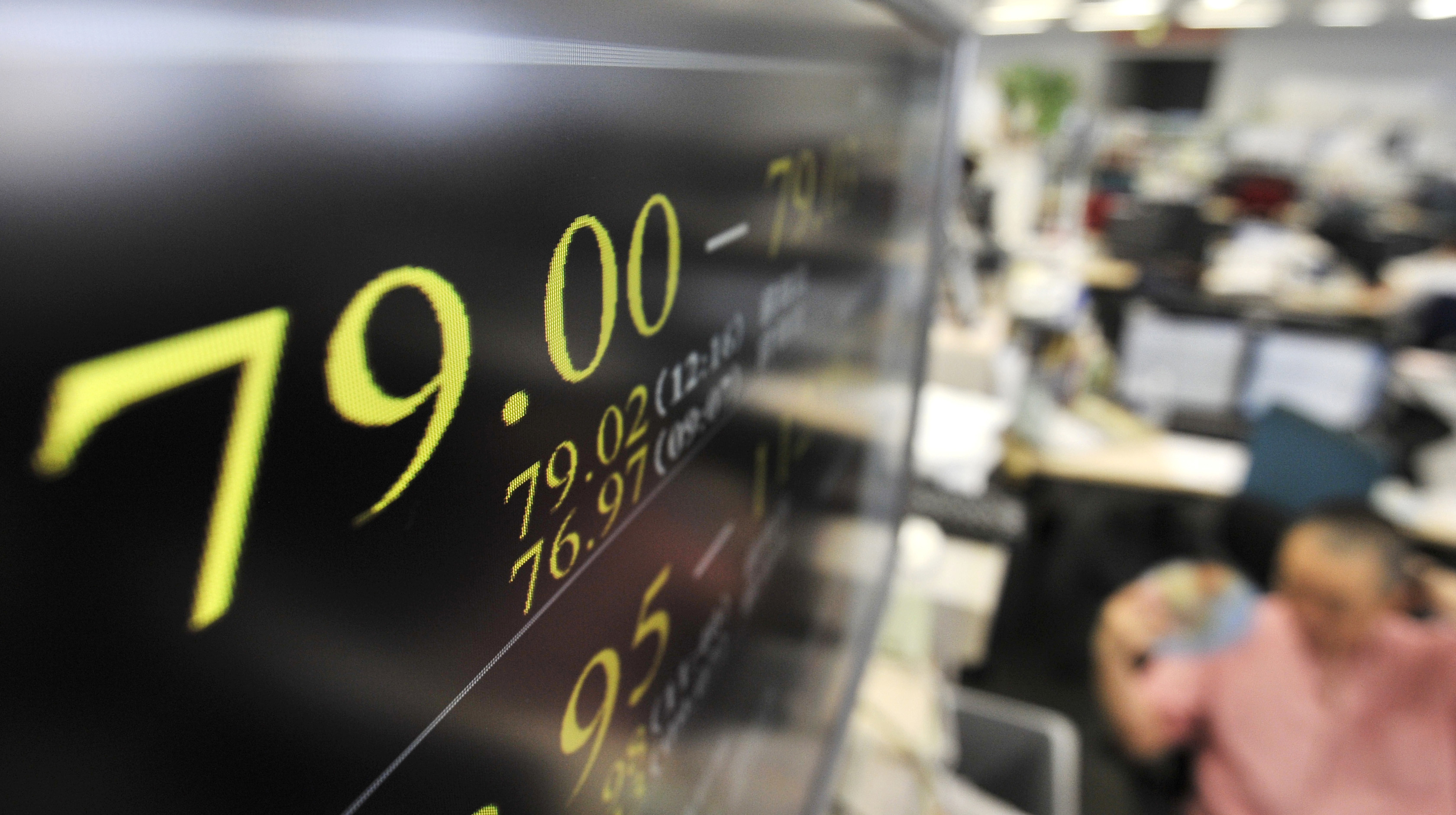 Uptick: An electronic board in Higashi-Shinbashi in Minato Ward, Tokyo, shows the dollar trading in the 79 yen level Thursday after Japanese monetary authorities intervened in the market to stem the yen's appreciation. | KYODO