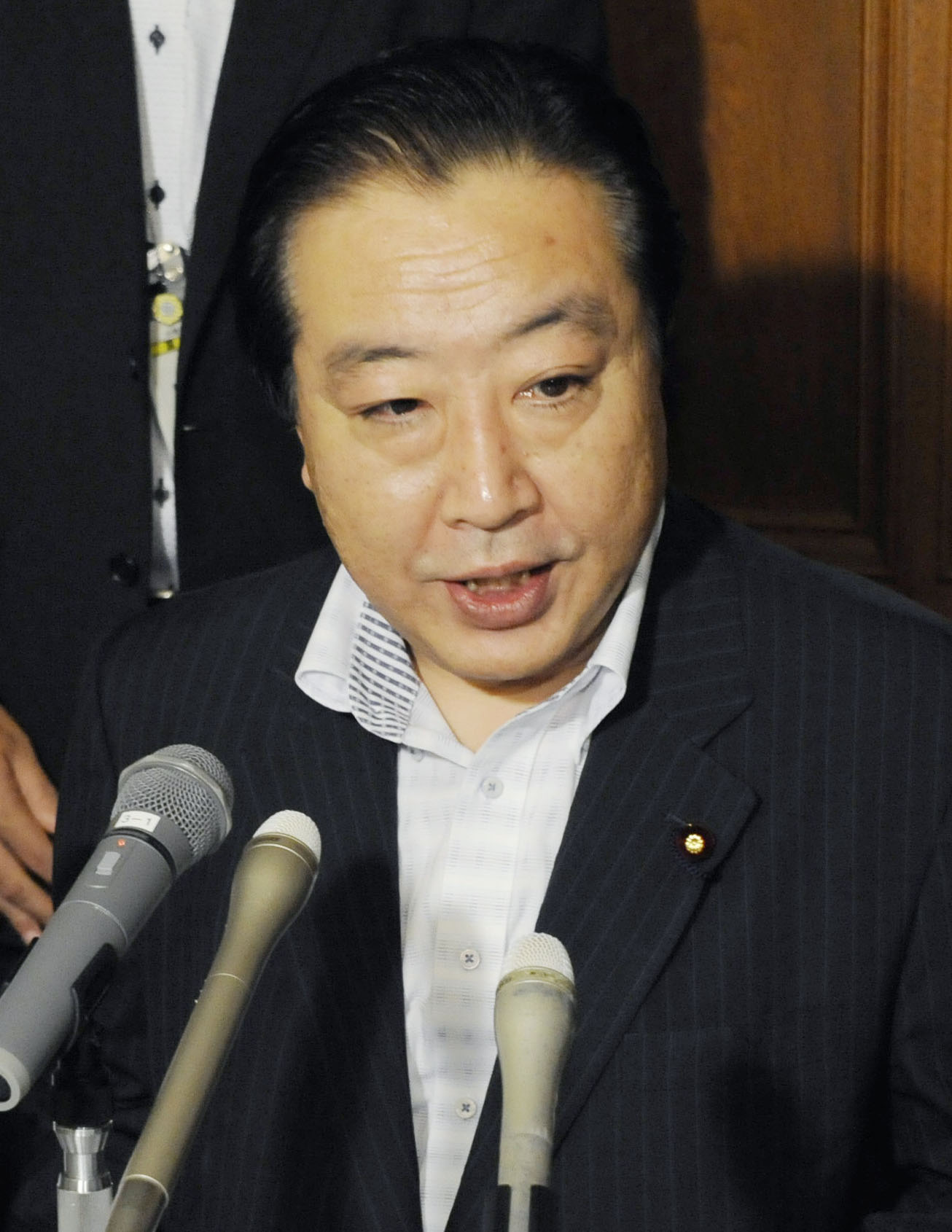My point of view: Finance Minister Yoshihiko Noda speaks to reporters in the Diet on Tuesday. | KYODO