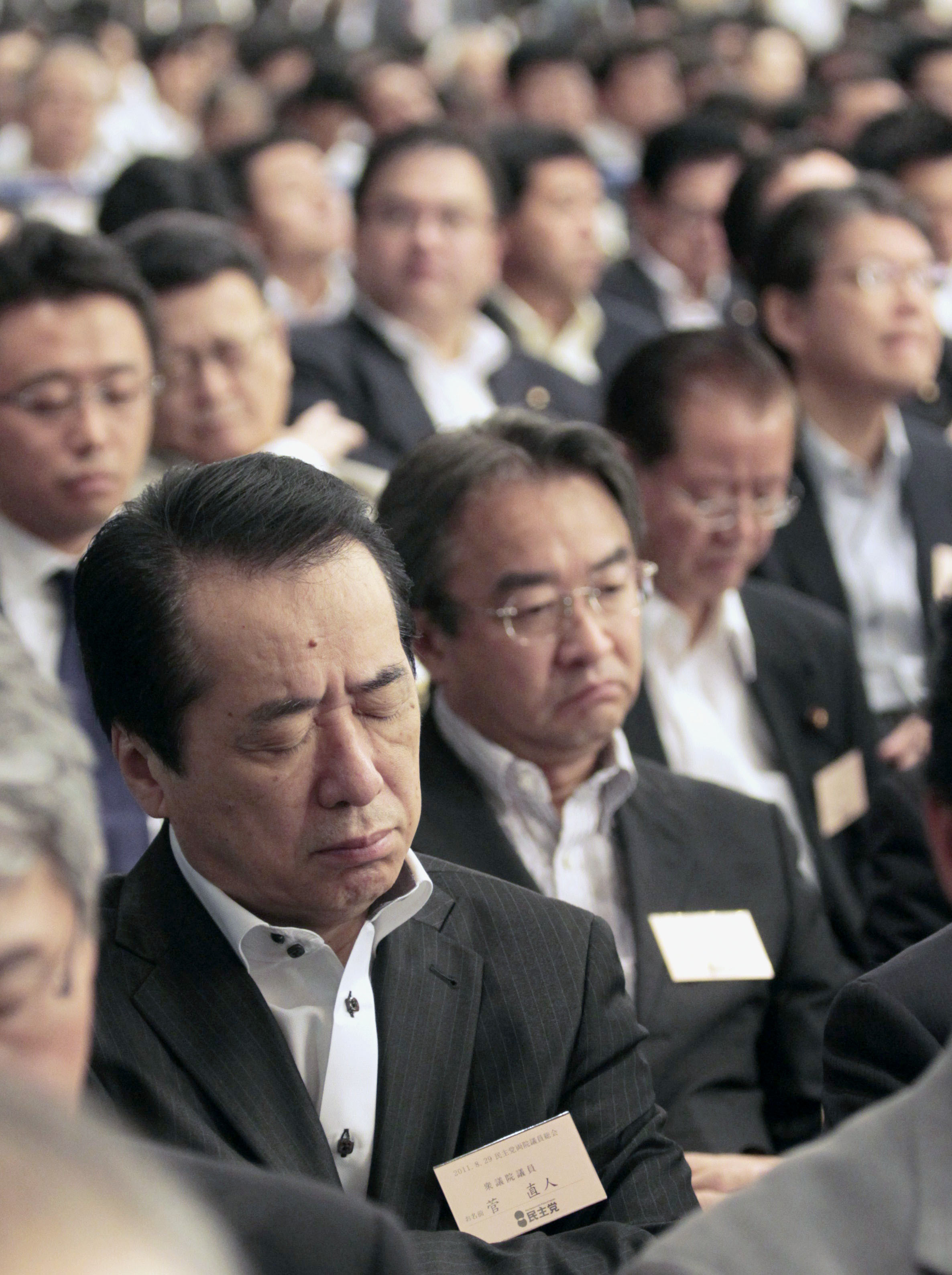 Departing Prime Minister Naoto Kan closes his eyes as he listens to the speeches of the five candidates.
