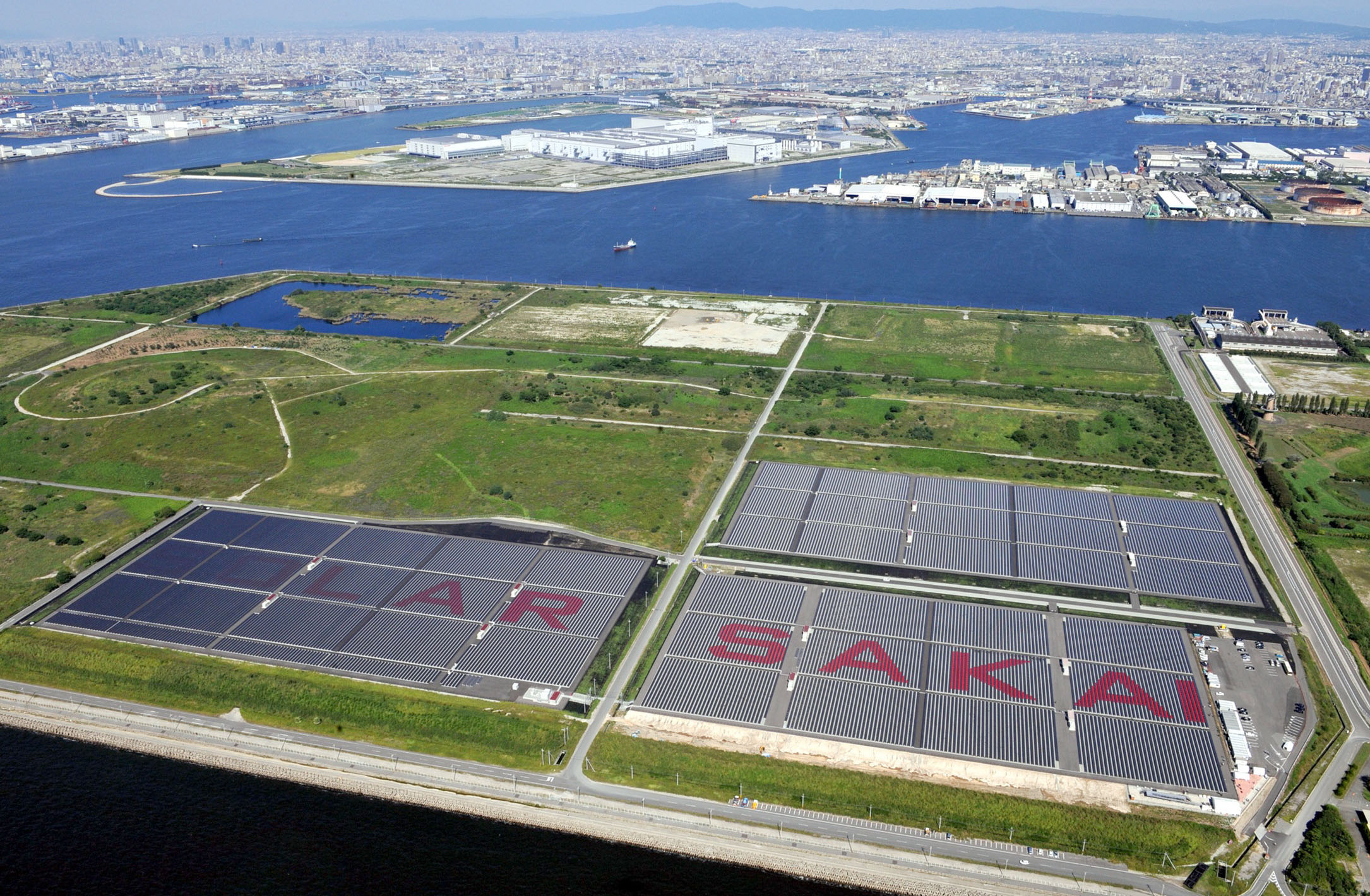 Sunny side up: Kansai Electric's solar power plant in Sakai, Osaka Prefecture, is seen Wednesday. | KYODO PHOTO