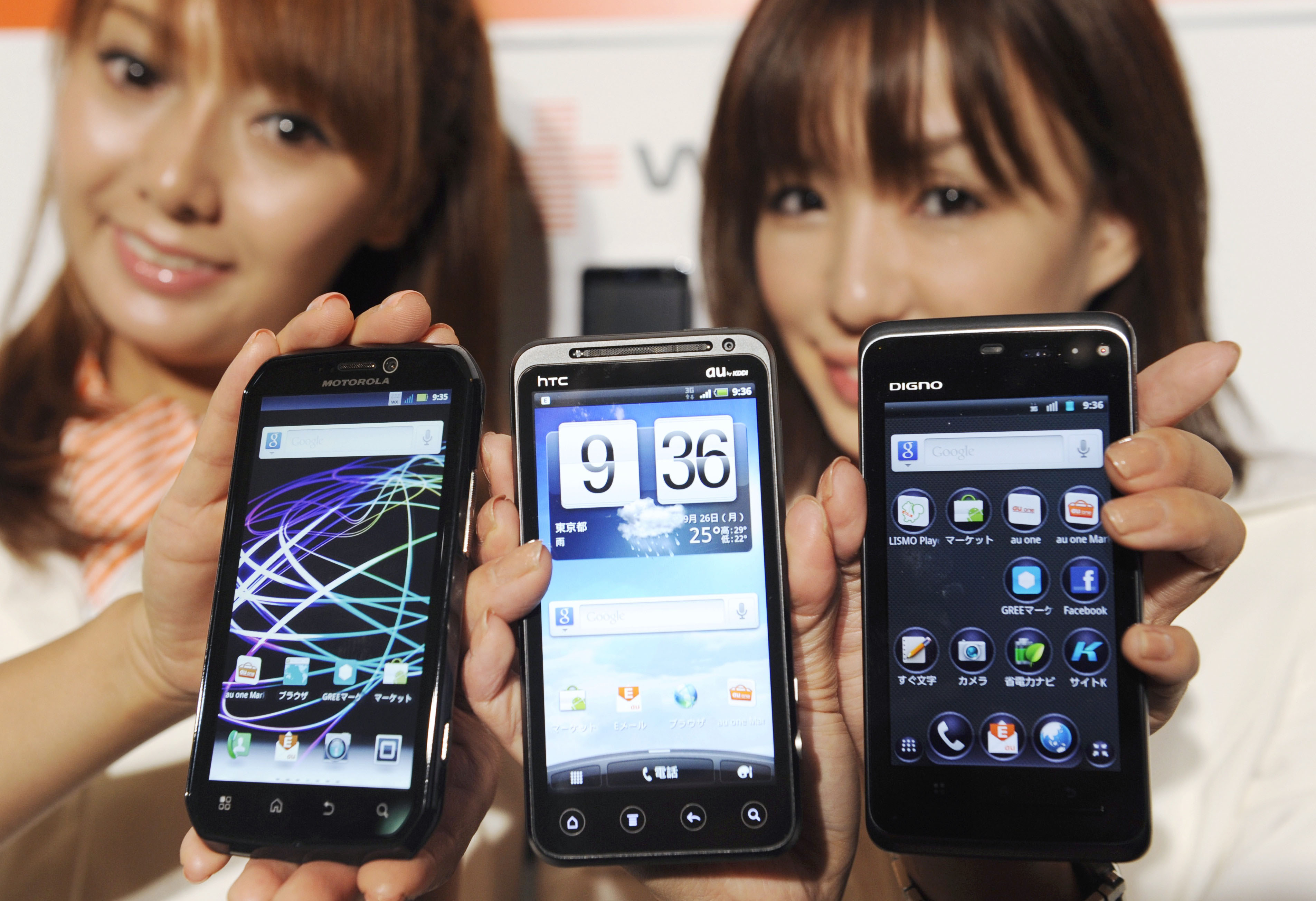 Upgrade: KDDI Corp.'s new smartphones, due for release in early October, are unveiled at a news conference in Tokyo on Monday. | KYODO PHOTO