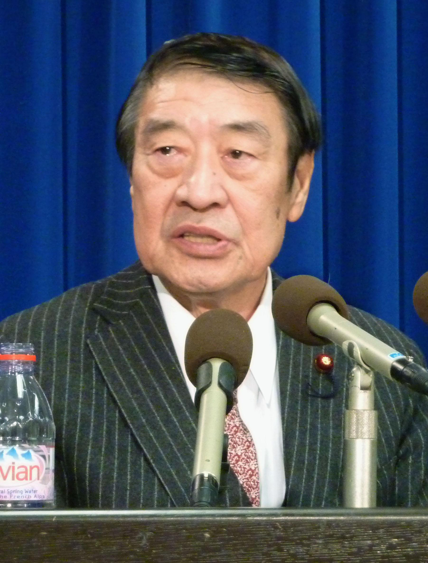 Tariff talk: Former farm minister Masahiko Yamada speaks to reporters in Washington on Wednesday. | KYODO