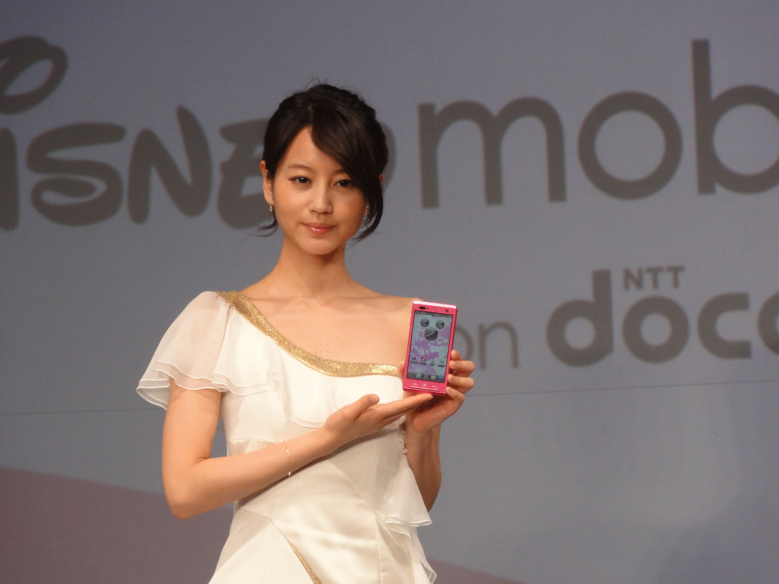 Smart move: Actress Maki Horikita displays an NTT DoCoMo Inc. Disney smartphone at a news conference Wednesday. The new gadget hits the market later this month. | KAZUAKI NAGATA