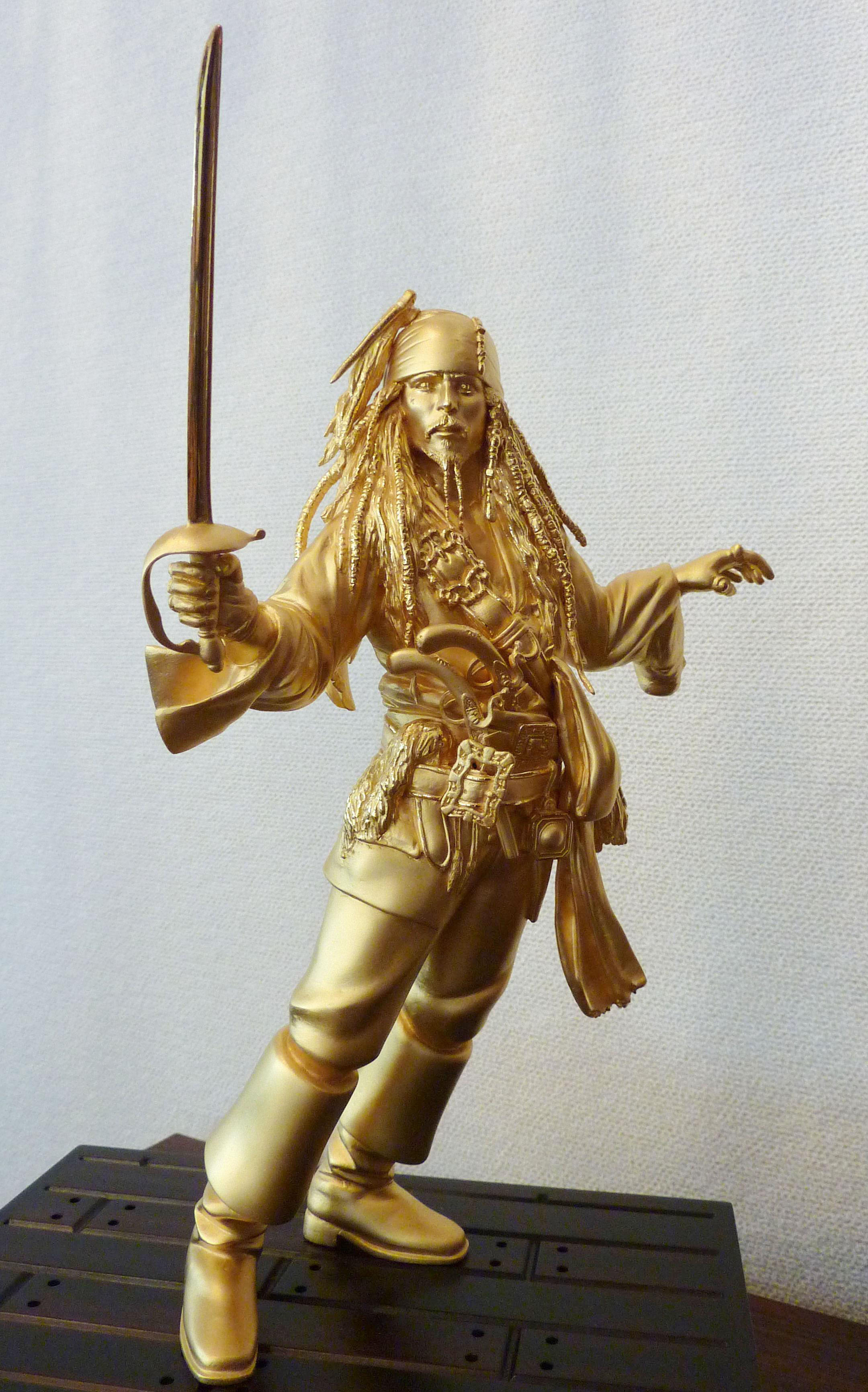 Pirate gold: A solid-gold figure of Jack Sparrow, the main character in the 'Pirates of the Caribbean' movies, is shown to the media Wednesday by Toyama-based Kurotani Corp. | KYODO