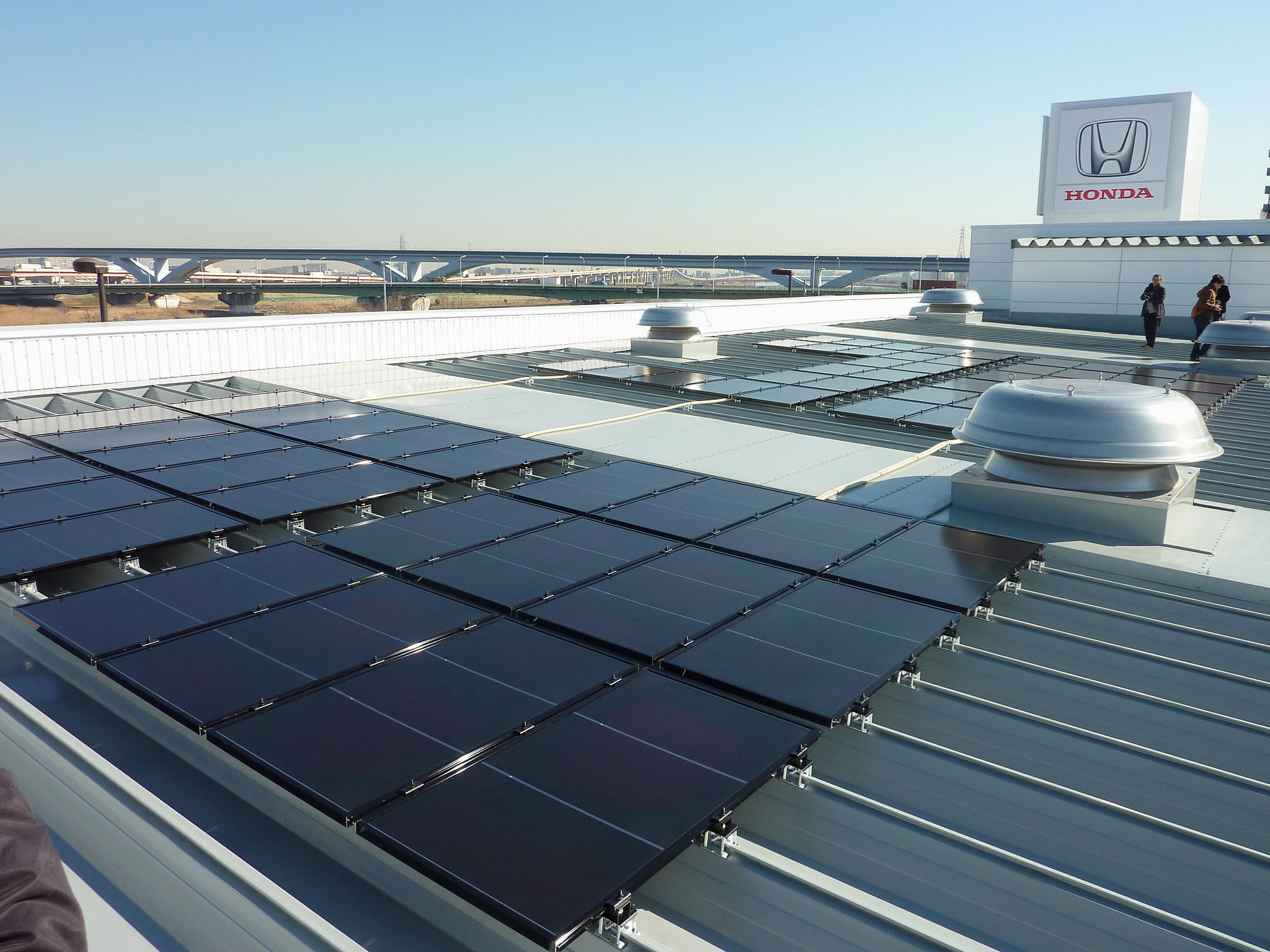 Sun power: Solar panels are installed on the roof of a Honda Motor Co. dealership in Adachi Ward, Tokyo, on Feb. 4. | KYODO
