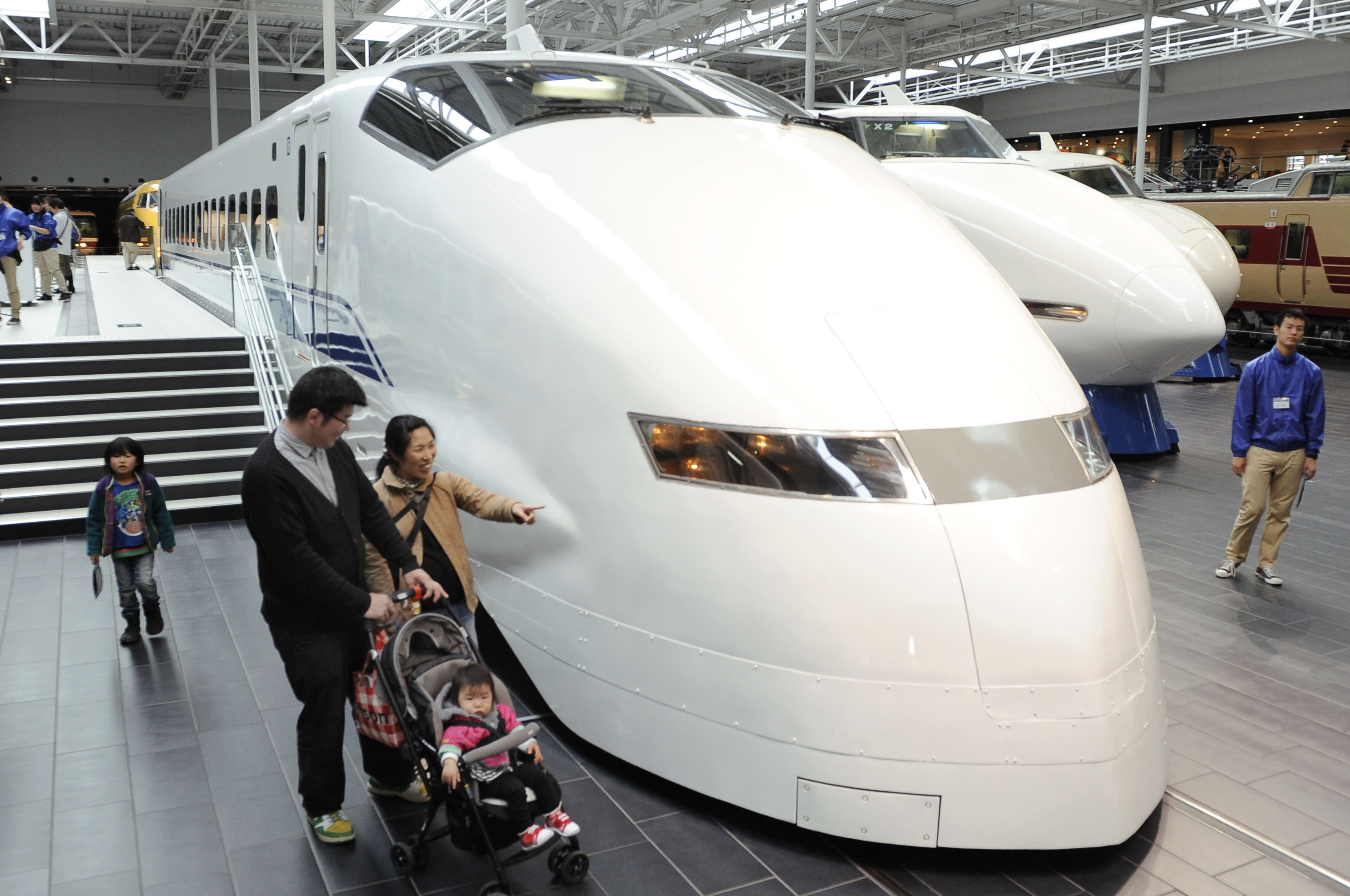 End of the line: Visitors view a 300 Series bullet train earlier this month at the SCMAGLEV and Railway Park in Nagoya. The 300 Series will be retired Friday before the Japan Railway Group releases its spring train schedules Saturday. | KYODO