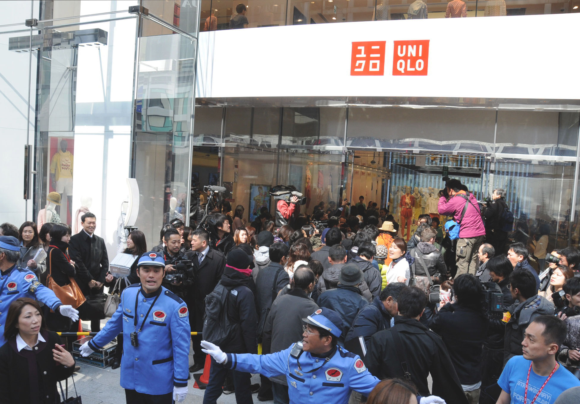 Till you drop: Shoppers enter the Uniqlo clothing chain's flagship store in Tokyo's Ginza district after it opened Friday morning. | SATOKO KAWASAKI