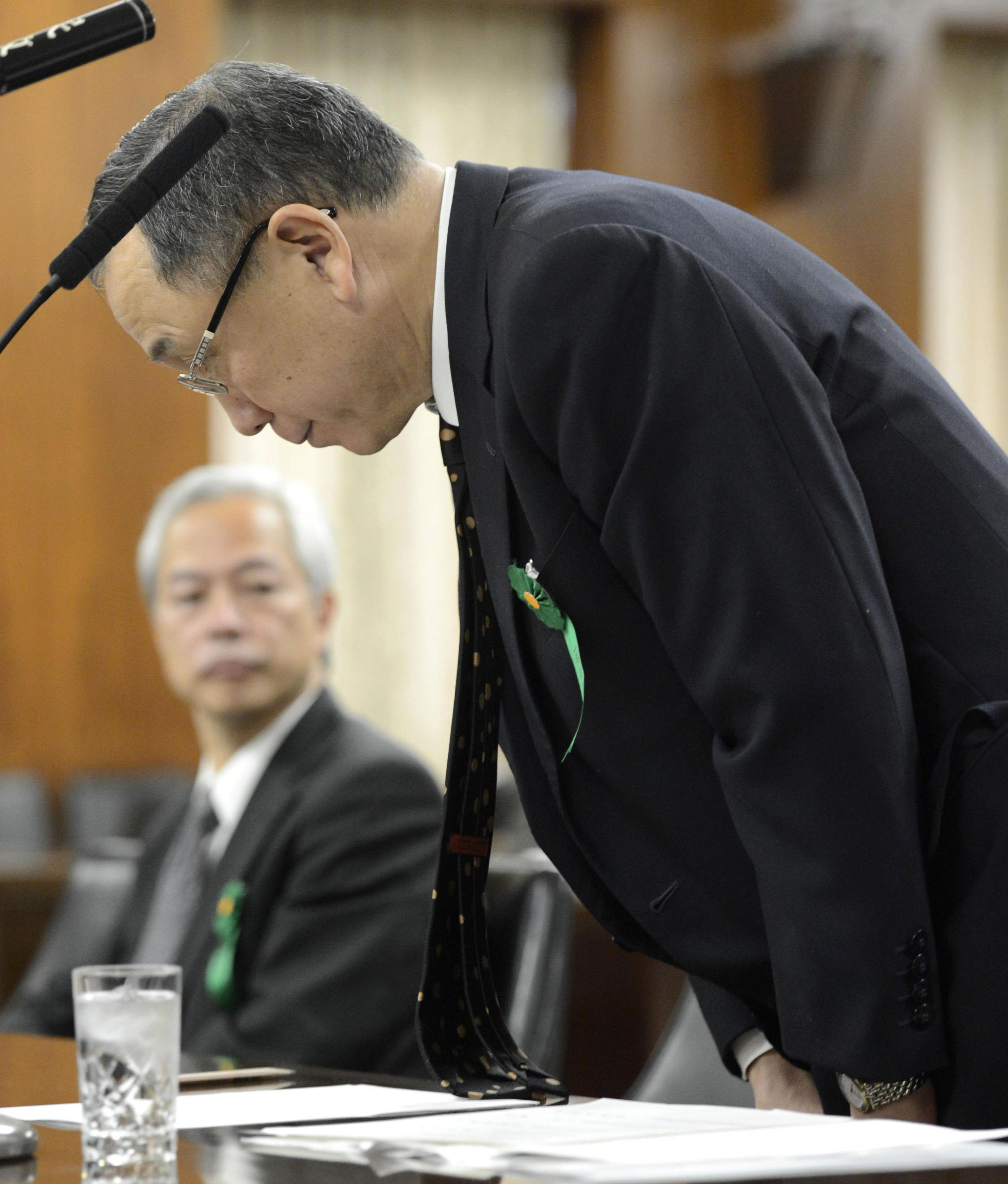 Denying complicity: AIJ Investment Advisors Co. President Kazuhiko Asakawa bows during a meeting of the Upper House Financial Affairs Committee on Tuesday. | KYODO