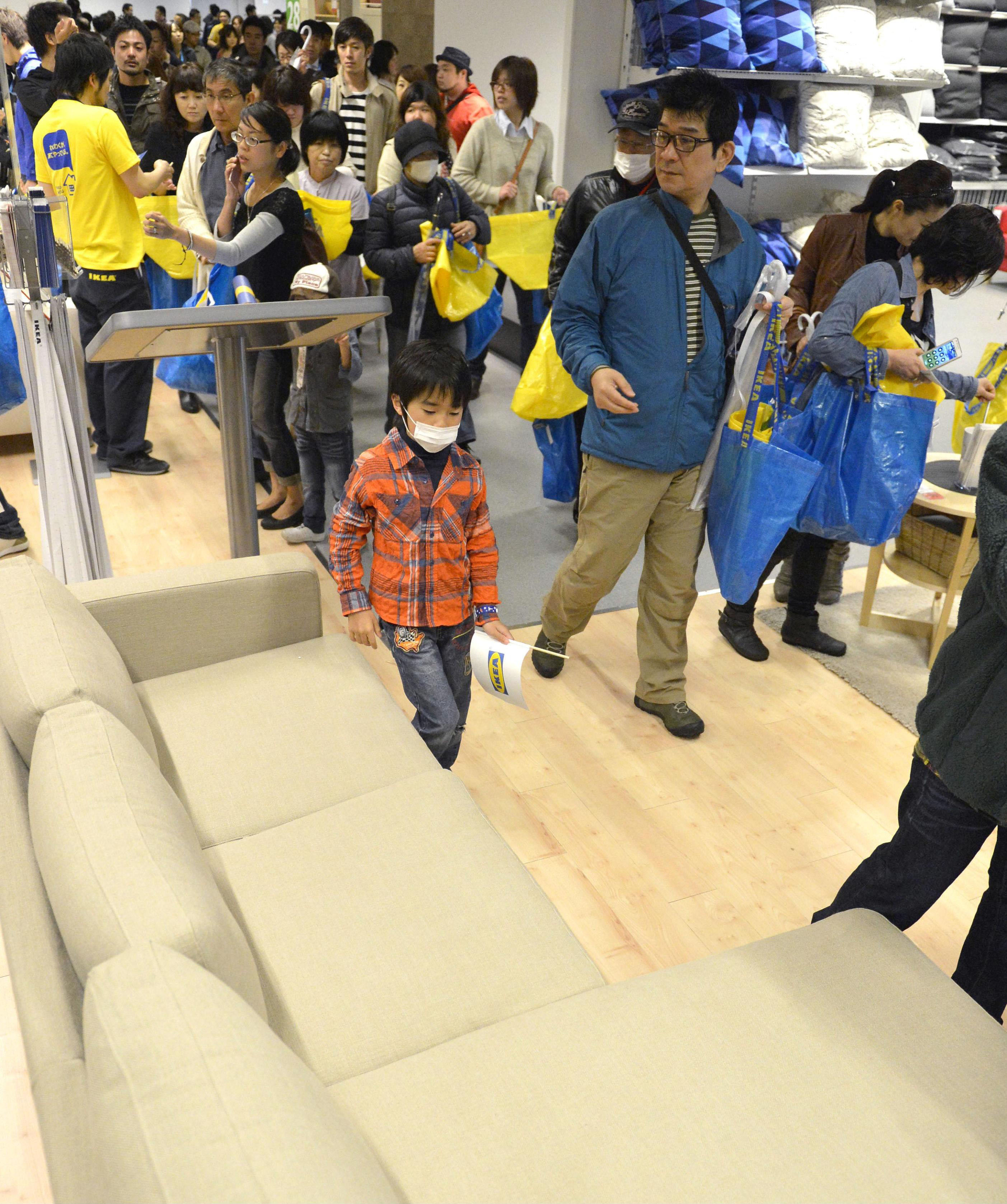 Furniture frenzy: Shoppers explore the newly opened Ikea outlet in Fukuoka on Wednesday. | KYODO