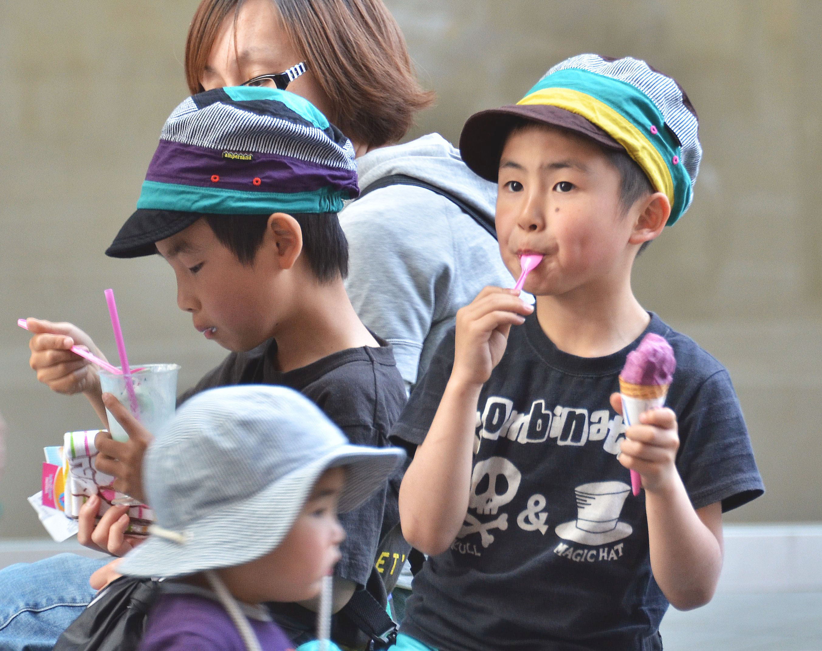 Cool treat: Children eat ice cream on a warm spring day in Tokyo on Sunday. Domestic makers of everything from ice cream to crayons are fretting about a long summer punctuated by power cuts that may hamper production. | AFP-JIJI