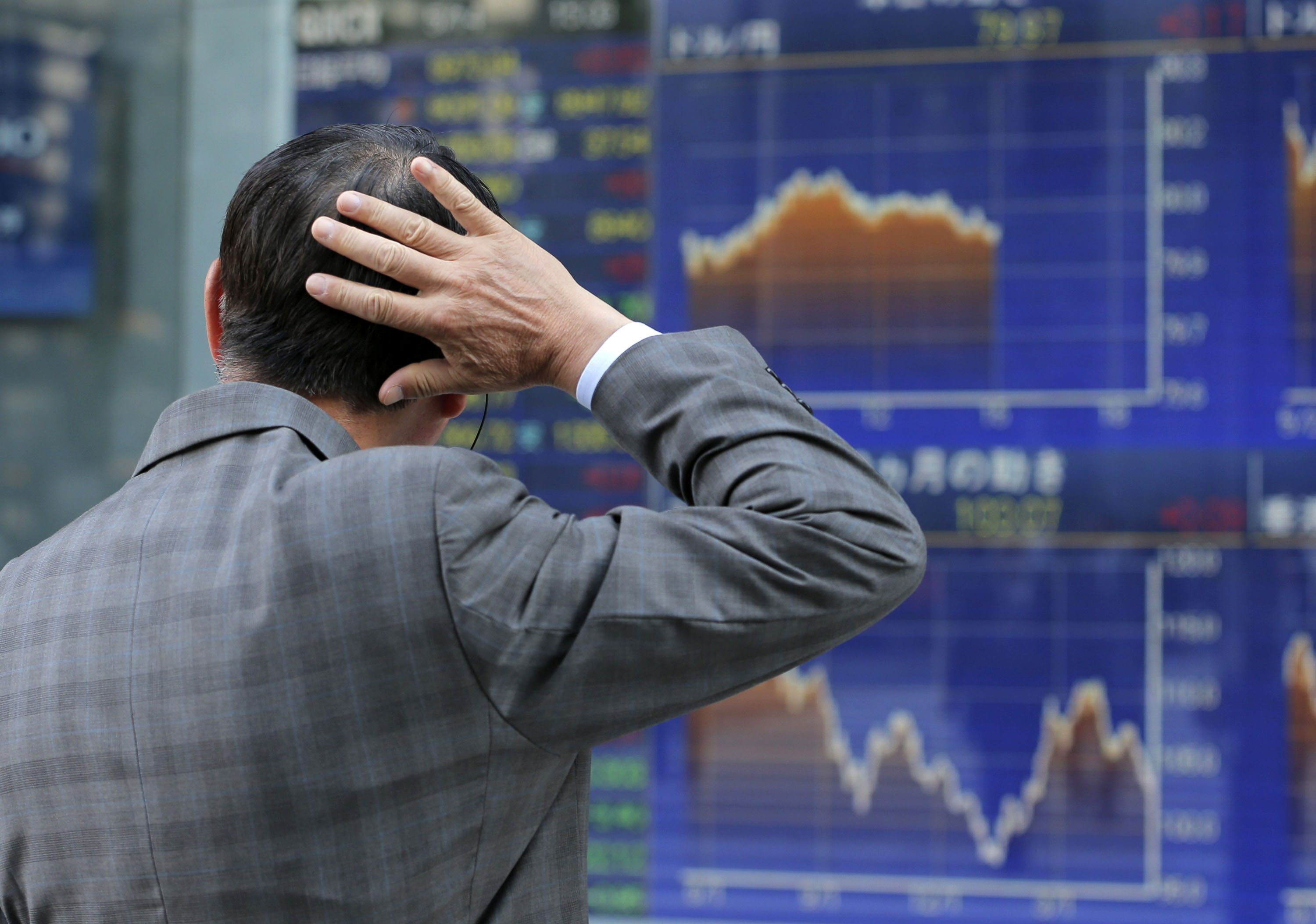 Bouncing bourse: A man watches an electronic stock indicator Monday in Tokyo. | AP