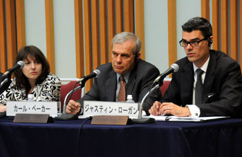 U.S. think tank experts (from left) Olga Oliker from RAND Corp., Carl Baker from the Center for Strategic and International Studies, and Justin Logan from the Cato Institute discuss economic and security challenges facing the United States and Japan during a symposium held April 27 at Keidanren Kaikan in Tokyo. | SATOKO KAWASAKI