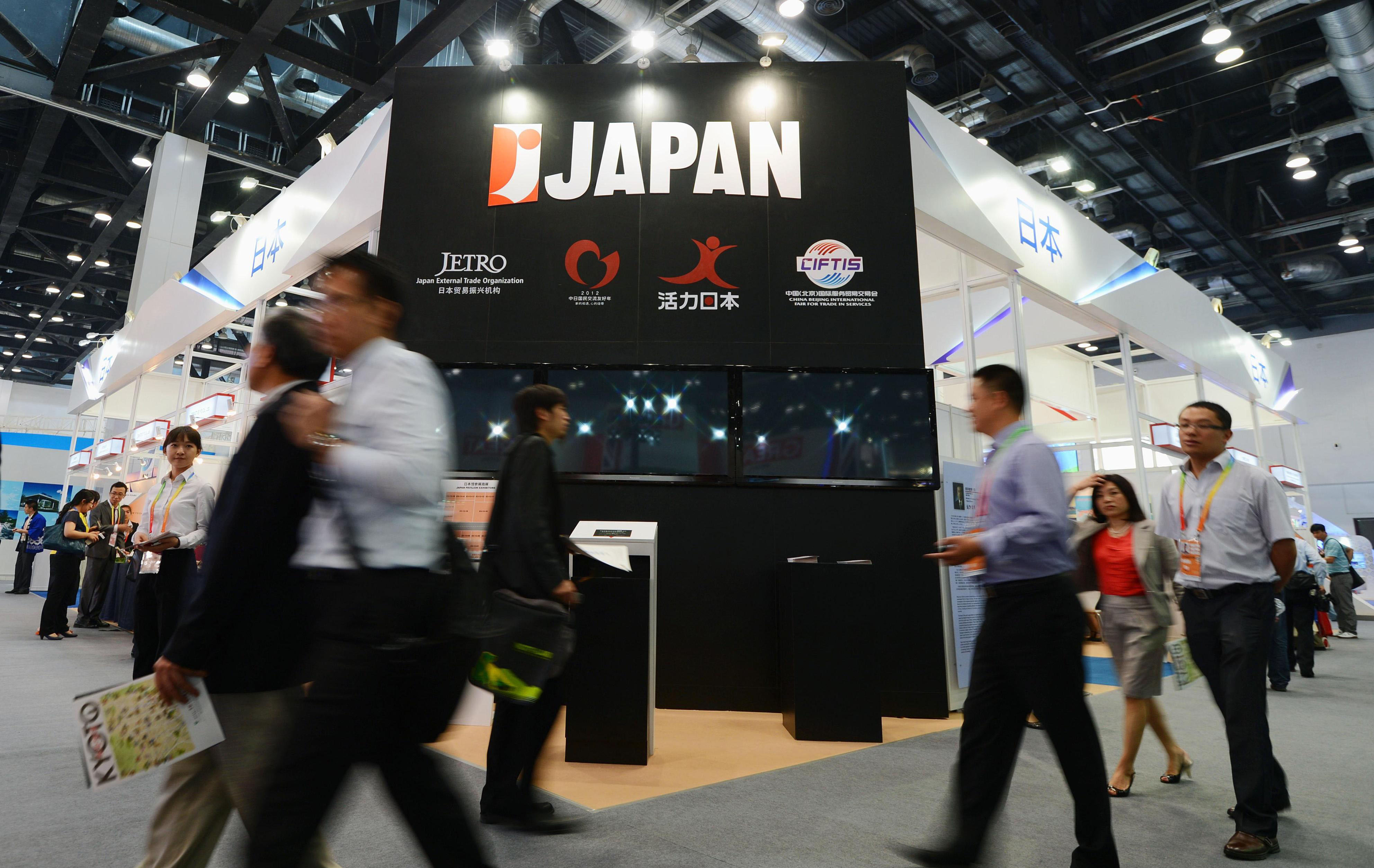 Hot cool: People pass the Japan booth, which is promoting quality services under the 'Cool Japan' campaign, on Monday, the first day of a five-day trade fair in Beijing. | KYODO