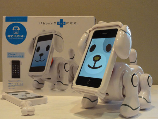 Phone fun: Bandai Co.'s Smart Pet, which has the body of a robot dog and an iPhone for a face that can be patterned as users like, is displayed at a Japan Toy Association news conference in Tokyo on Tuesday. | KAZUAKI NAGATA
