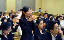 In demand: A Chinese student quizzes corporate representatives at a recruitment seminar Saturday in Tokyo held by six Japanese firms, including Panasonic Corp., that are eager to hire them.   KYODO