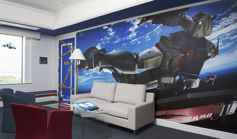 Bed and 'bot: A guest room at the Grand Pacific Le Daiba hotel features illustrations from the popular 'Gundam' animated series. | GRAND PACIFIC LE DAIBA