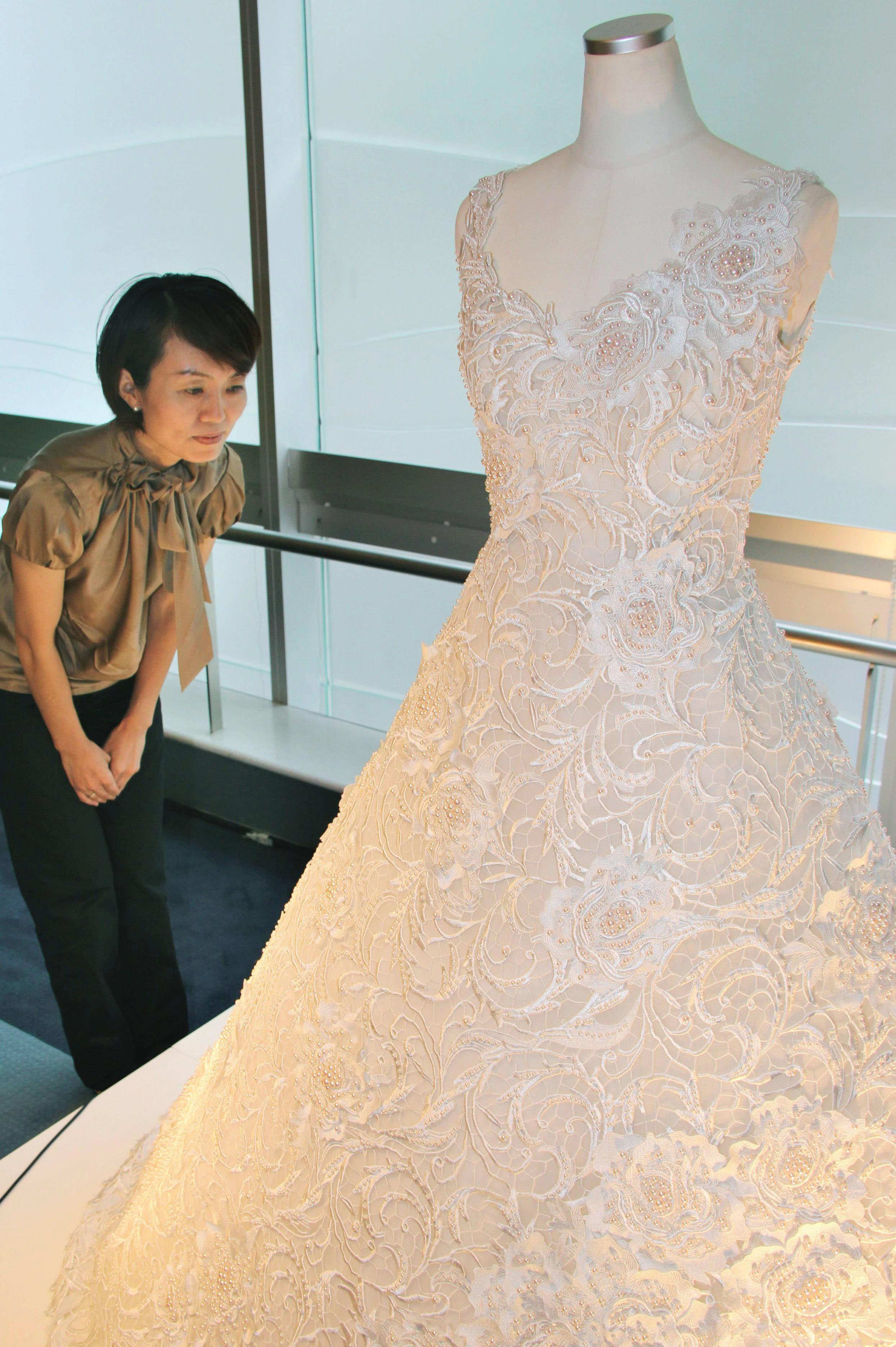 Pearl-inlaid wedding dress showcased