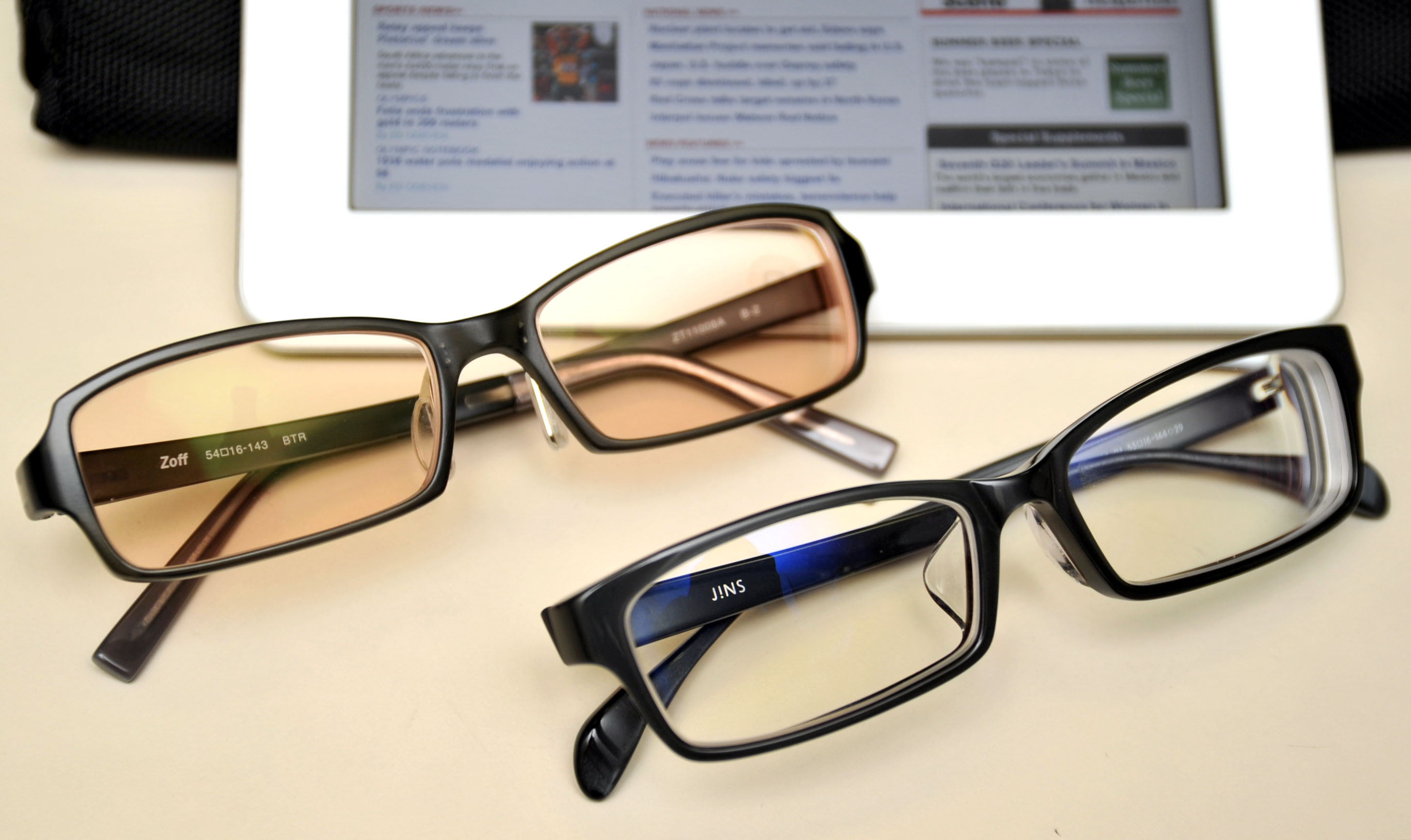 A sight for sore eyes: Computer glasses, either with brown-tinted lenses (top) or clear lenses, are apparently helping to cut the amount of eye exposure to blue light emitted from electronic screens. | YOSHIAKI MIURA
