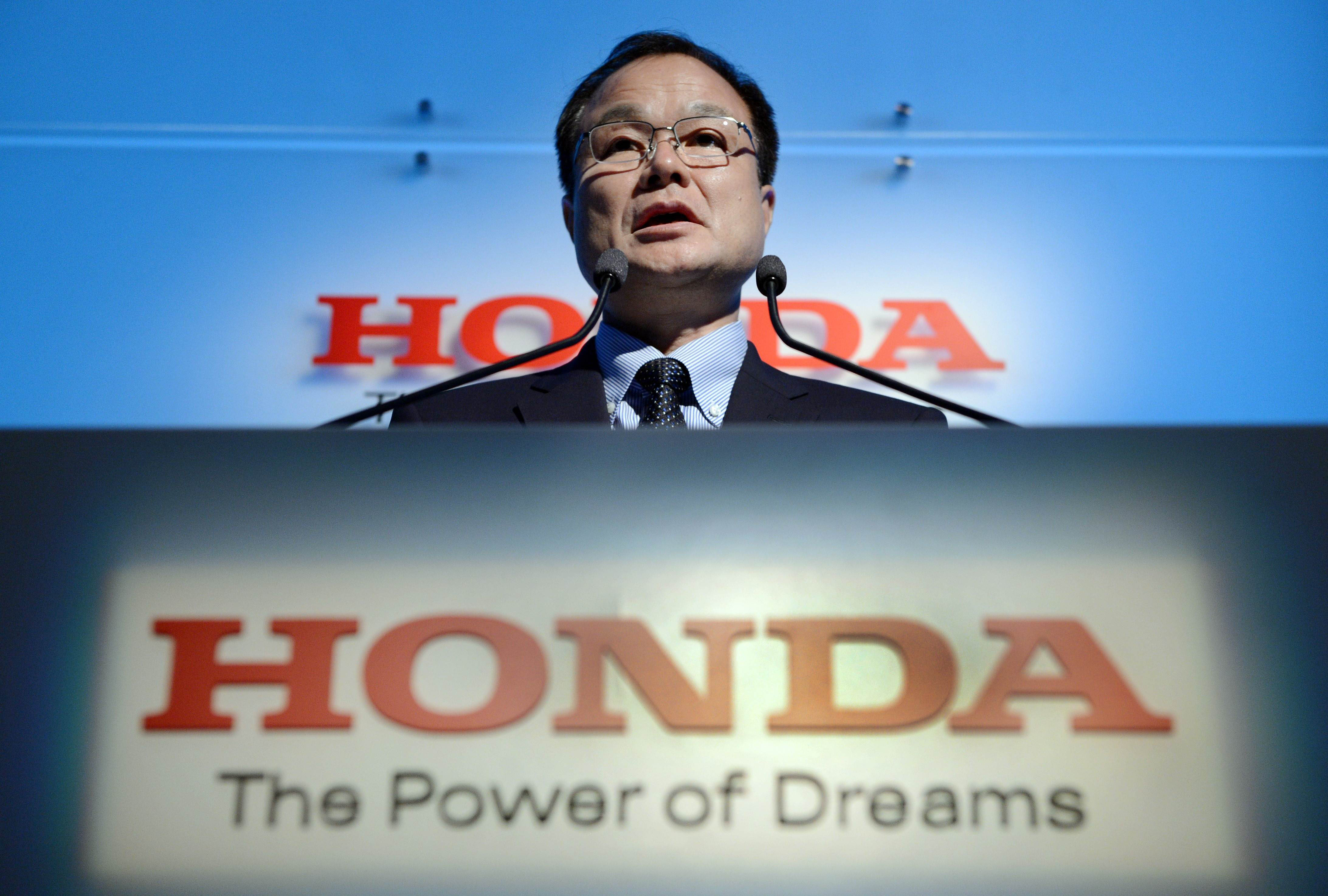 Moving forward:  Takanobu Ito, president of Honda Motor Co., holds a news conference at the automaker's headquarters in Tokyo on Friday. | AFP-JIJI