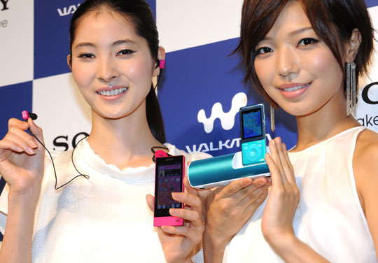 Jams in progress: Models display Sony Corp.'s latest digital Walkman series, the Android OS-based F800 (left) with a Bluetooth wireless headphone, and an S770 series MP3 player with a speaker and FM radio recharging cradle in Tokyo on Thursday. | AFP-JIJI