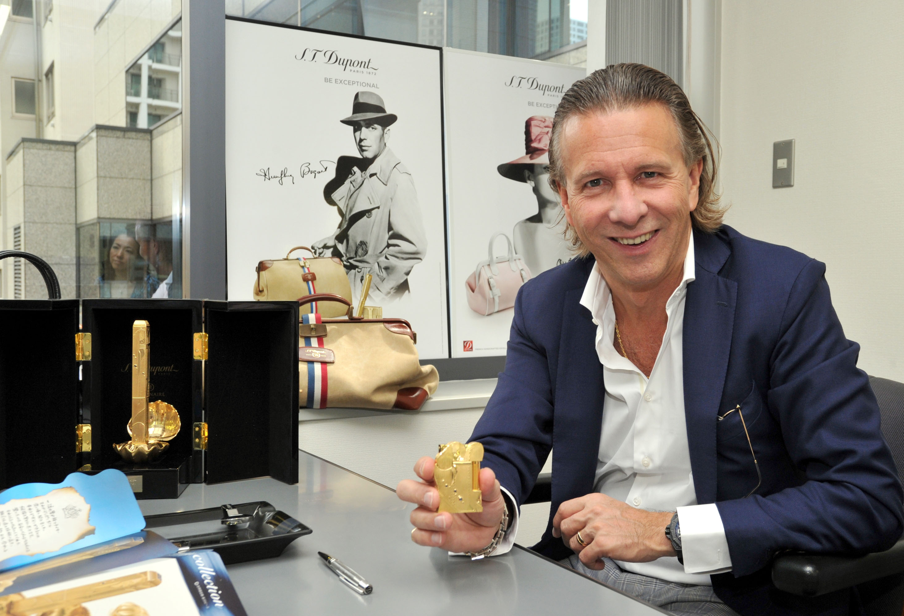 The right light: S.T. Dupont CEO Alain Crevet holds a lighter designed by Eiichiro Oda, the author of the popular manga 'One Piece,' at the firm's  Tokyo office in Minato  Ward on Sept. 28. | YOSHIAKI MIURA