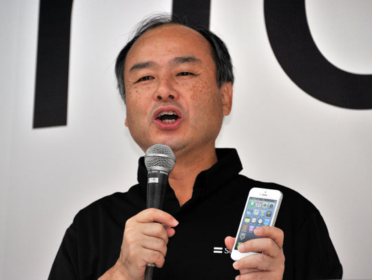 Man of the hour: Softbank President Masayoshi Son speaks at a launch ceremony for the Apple iPhone 5 at a Softbank mobile phone shop in  Tokyo on Sept. 21. | AFP-JIJI