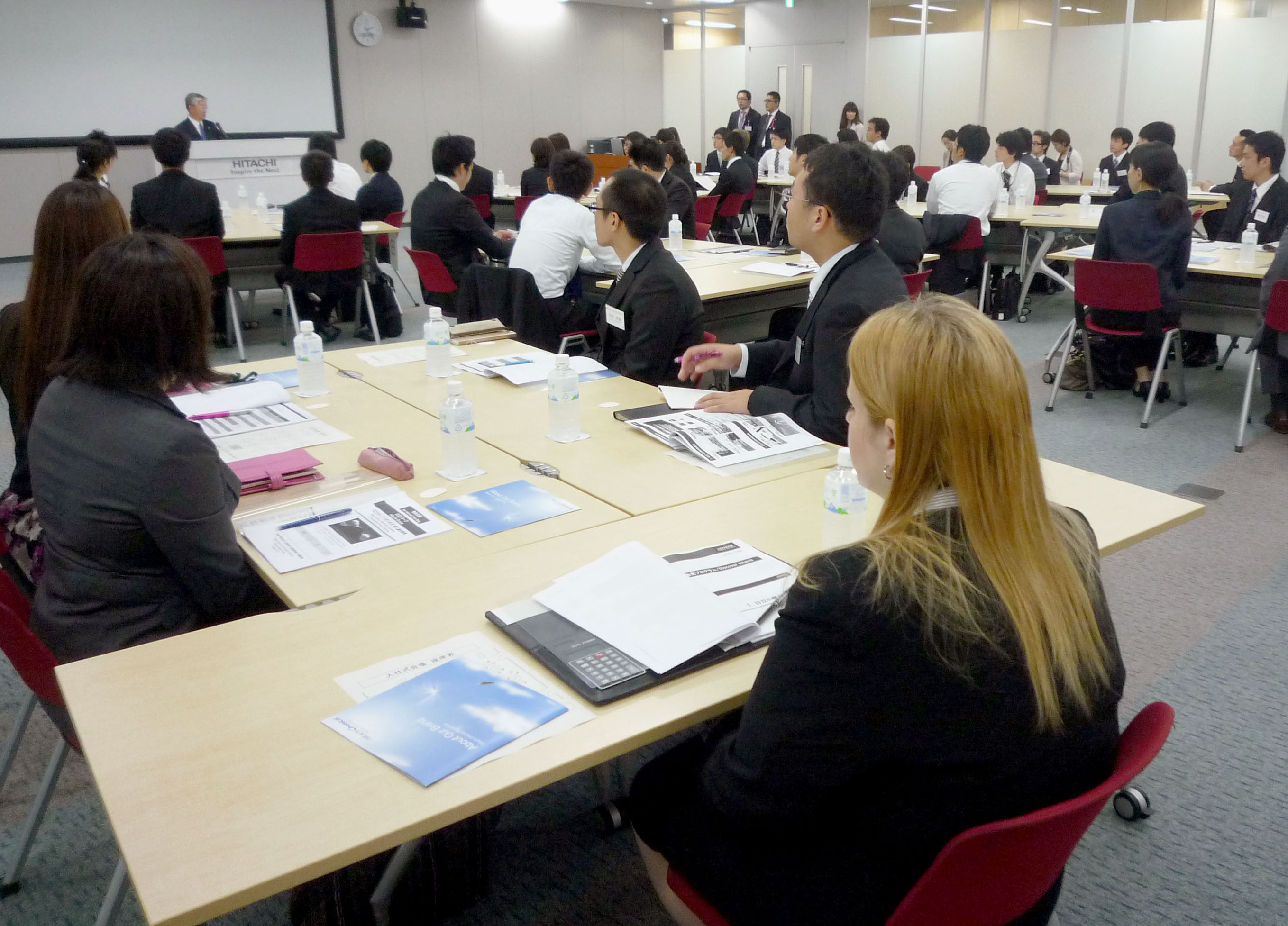 Welcome aboard: Hitachi holds its first fall initiation ceremony on Oct. 1 at its headquarters in Chiyoda Ward, Tokyo. | KYODO