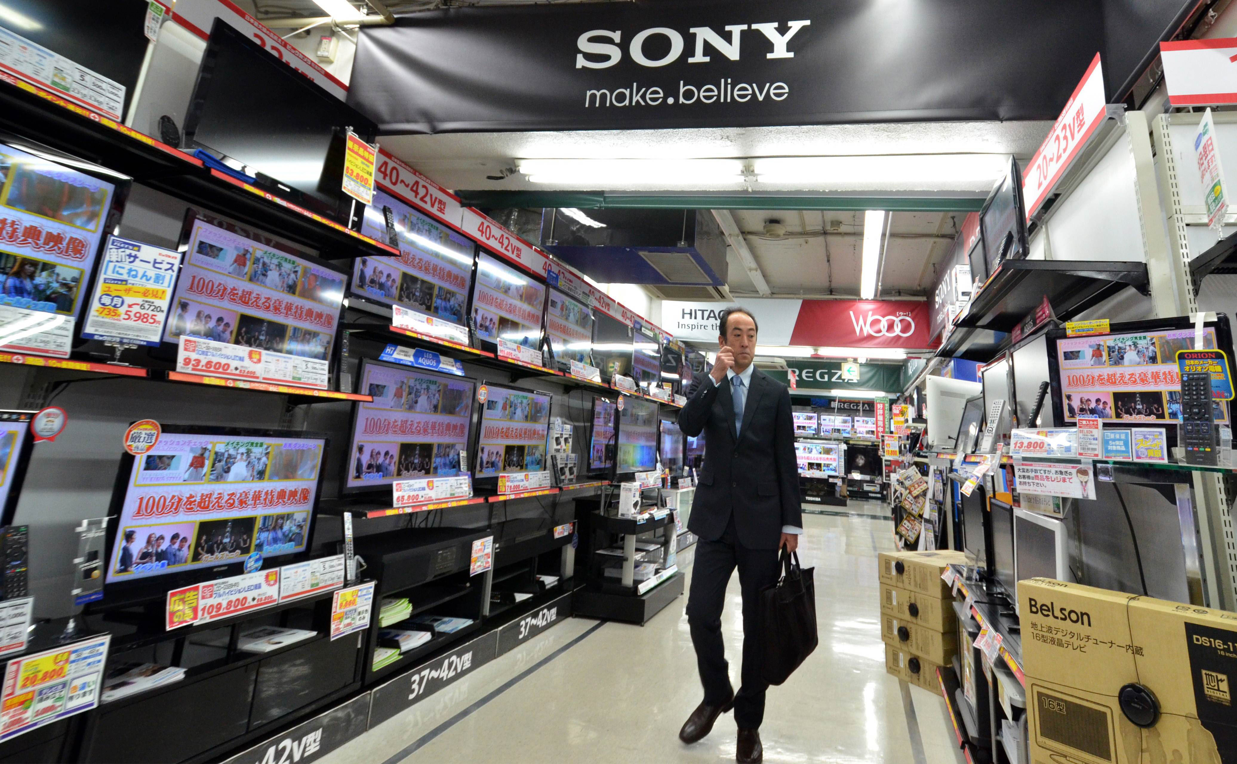 Screening process: A customer browses through Sony LCD TVs at an electronics shop in Tokyo on Thursday. | AFP-JIJI