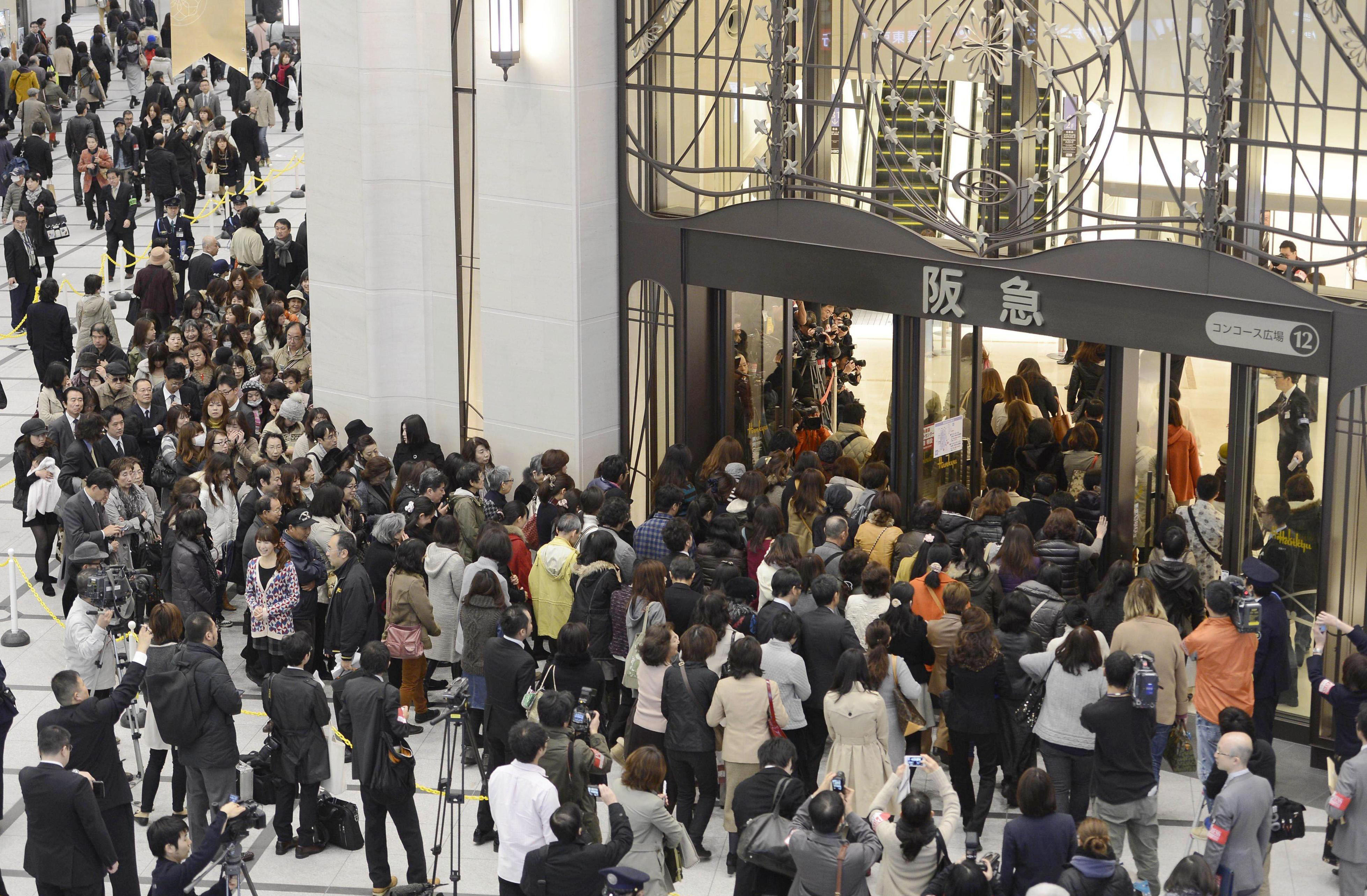 Good as new: Shoppers enter Hankyu's flagship in Umeda, Osaka, on Wednesday. All the retail space is now open in the emporium, which began to undergo refurbishment in 2005. | KYODO