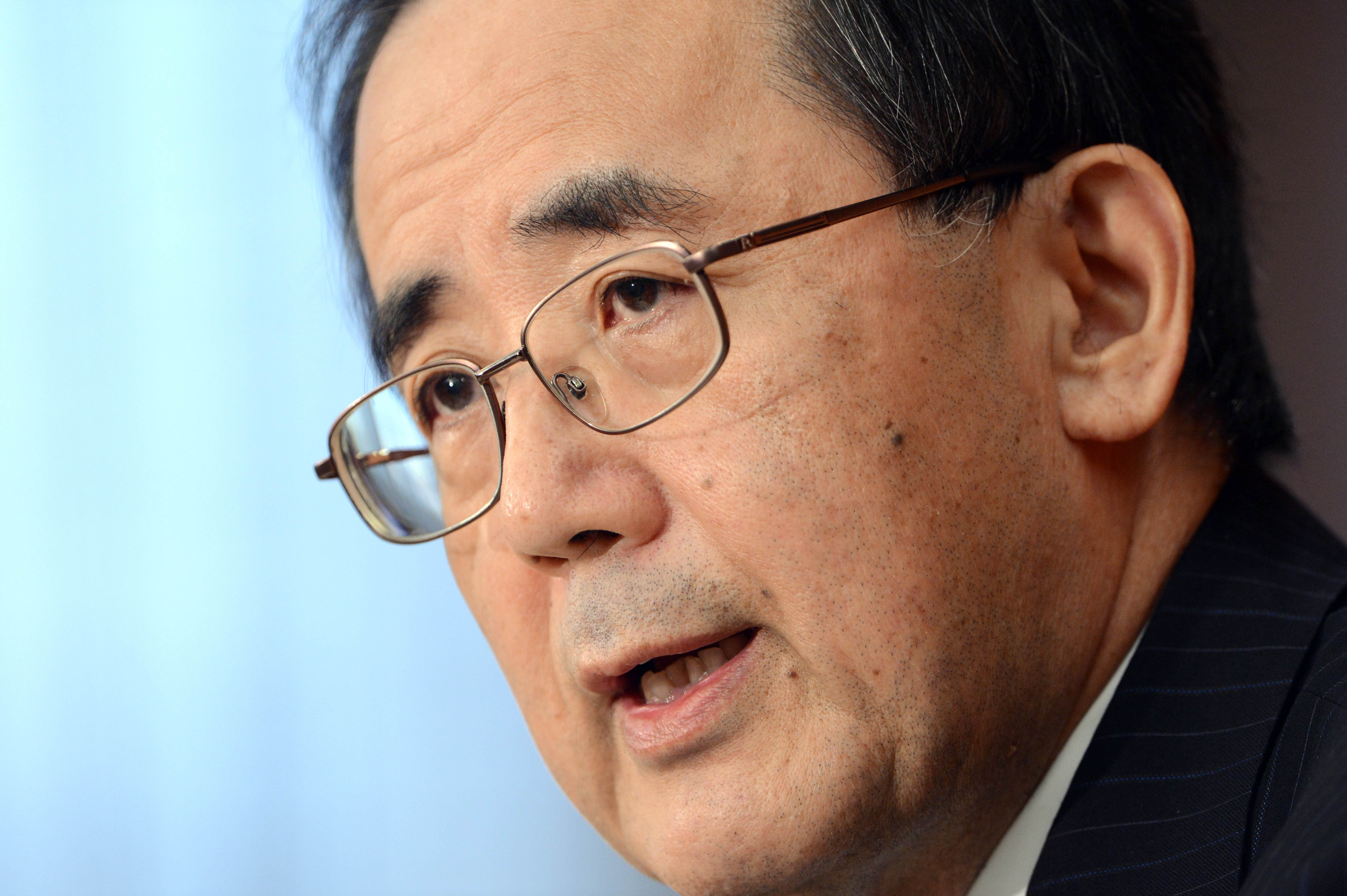 In the cross hairs: Bank of Japan Gov. Masaaki Shirakawa speaks at a news conference in Tokyo on Tuesday. | AFP-JIJI