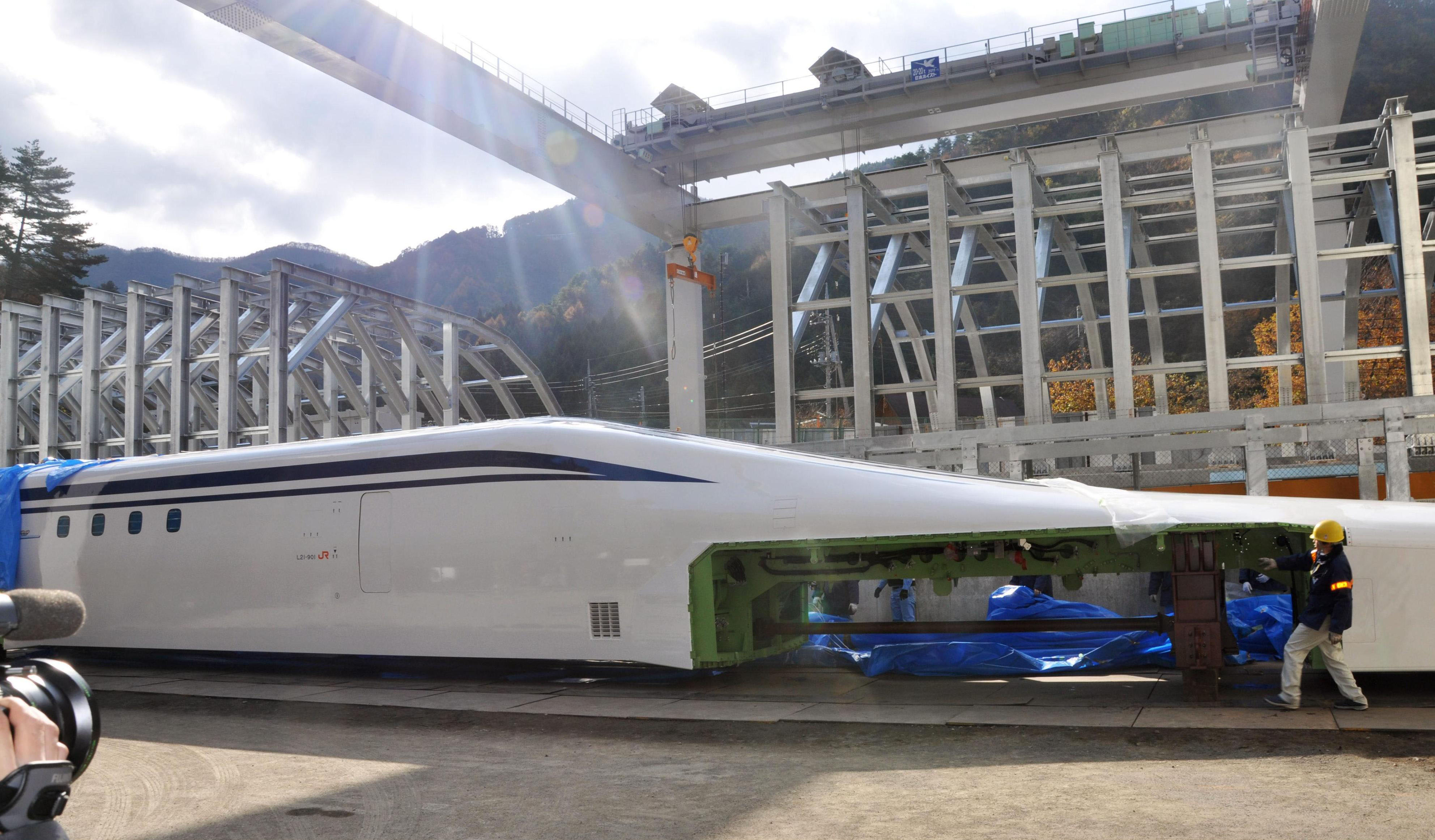 Ready to levitate: The new L0 series maglev train is transferred to a test facility yard Thursday in Tsuru,Yamanashi Prefecture. | KYODO