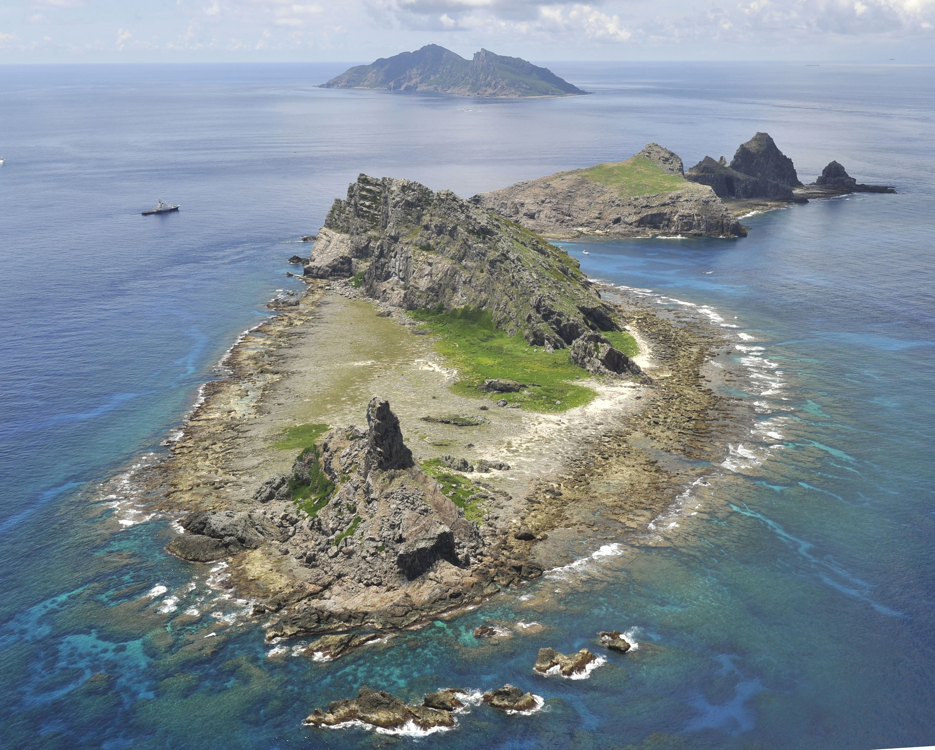 Strong undercurrents: The disputed Senkaku Islands in the East China Sea are seen in September. | KYODO