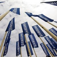 Sky's the limit: Flags bearing Samsung's logo hang outside the IFA consumer electronics fair in Berlin in August 2011. | BLOOMBERG